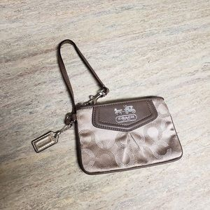Coach wristlet with horse and carriage